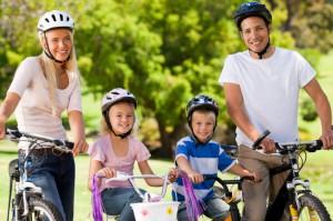Family-riding-bikes-300x199.jpg